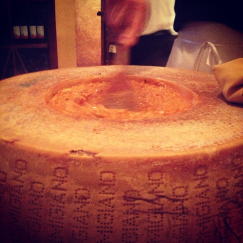 The coolest dish I've ever seen -- risotto prepared tableside in a giant block of cheese. It costs $1500!