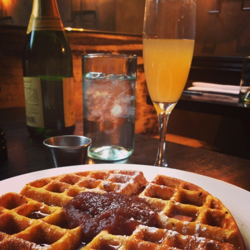 Pumpkin spice waffle with apple butter and peach bellini.